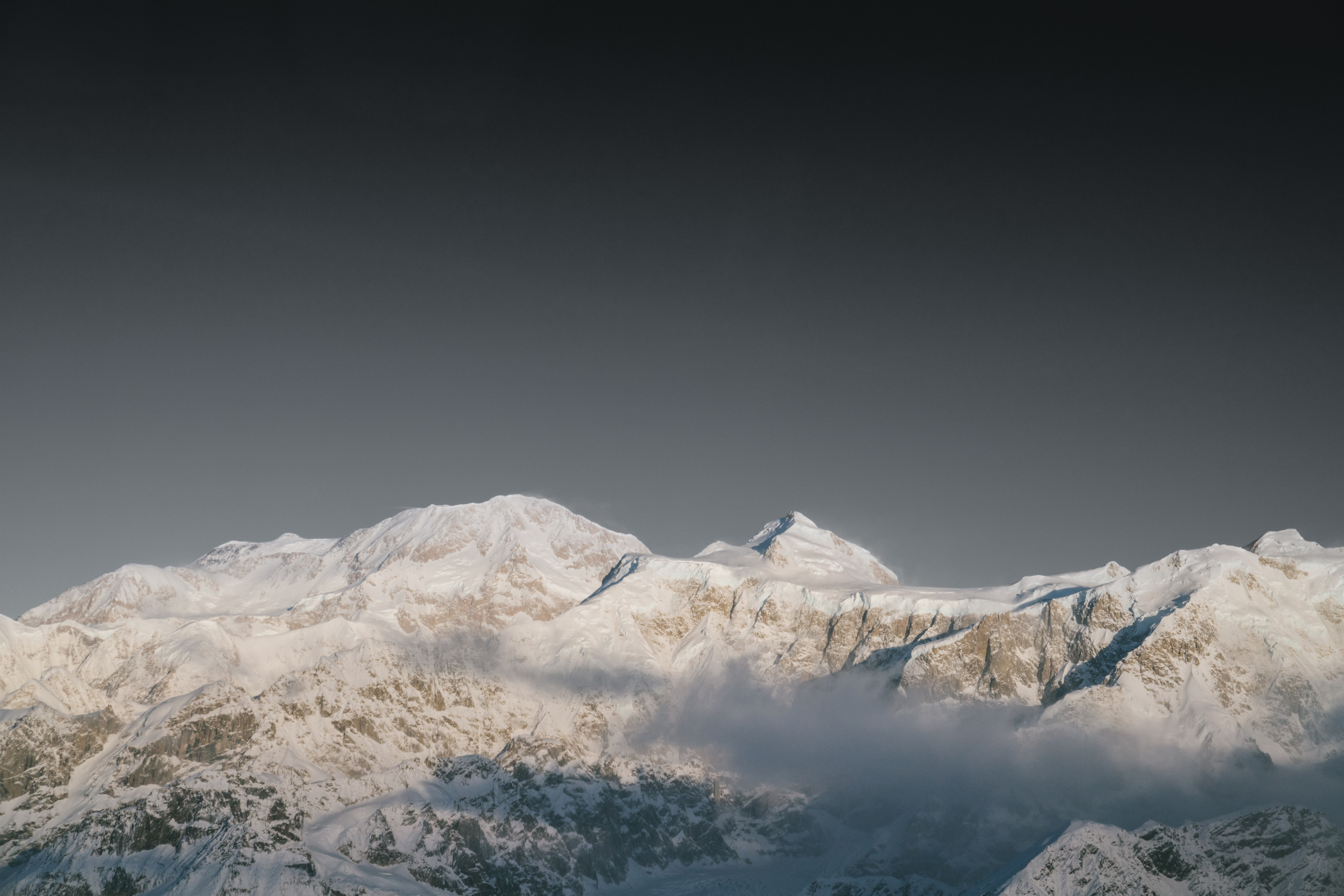 mountain range covered with white snow