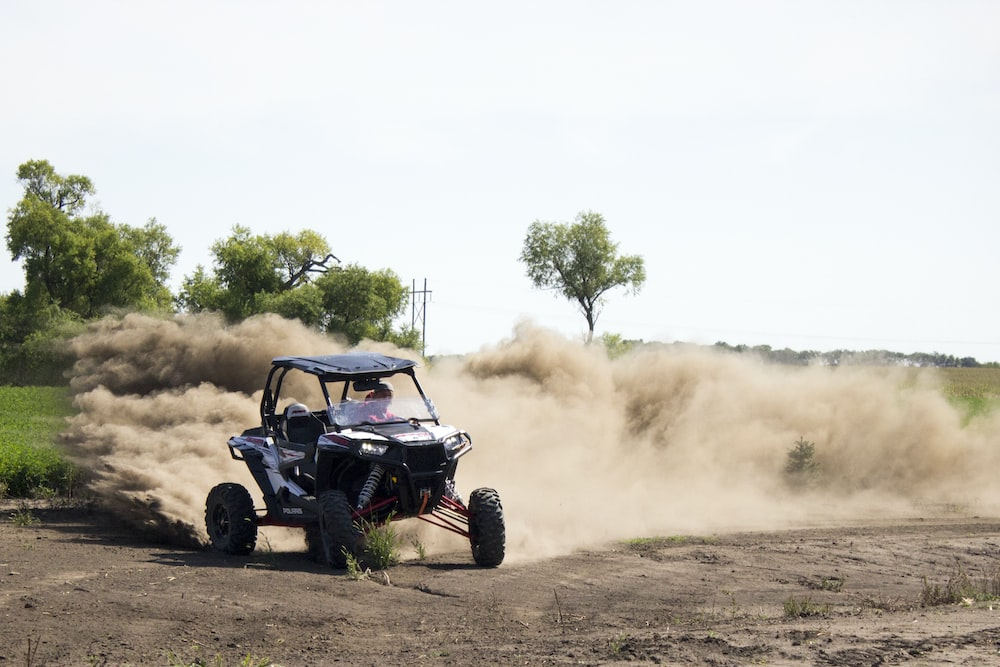 drifting UTV at the field during day