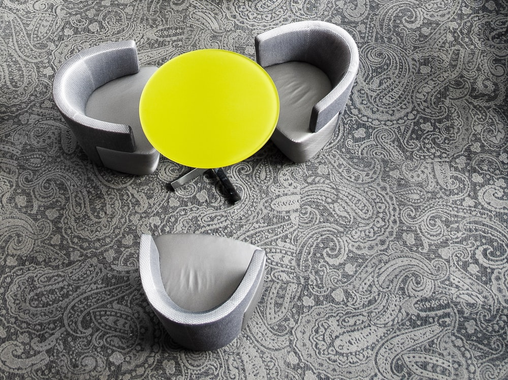 round yellow glass top table three silver tub chairs set