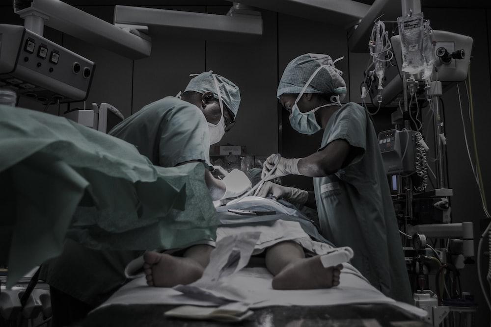 doctors treating patient