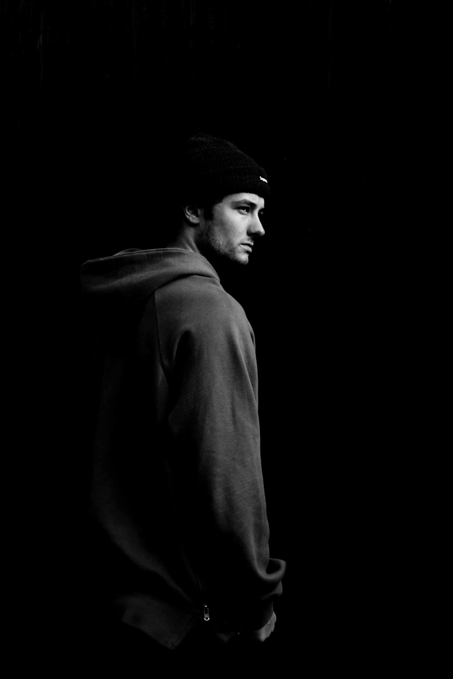 grayscale photo of man wearing hoodie and knit cap
