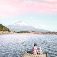 two children sitting on dock