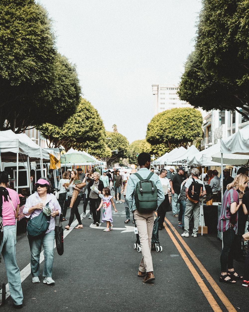 people walking on walkway during daytime
