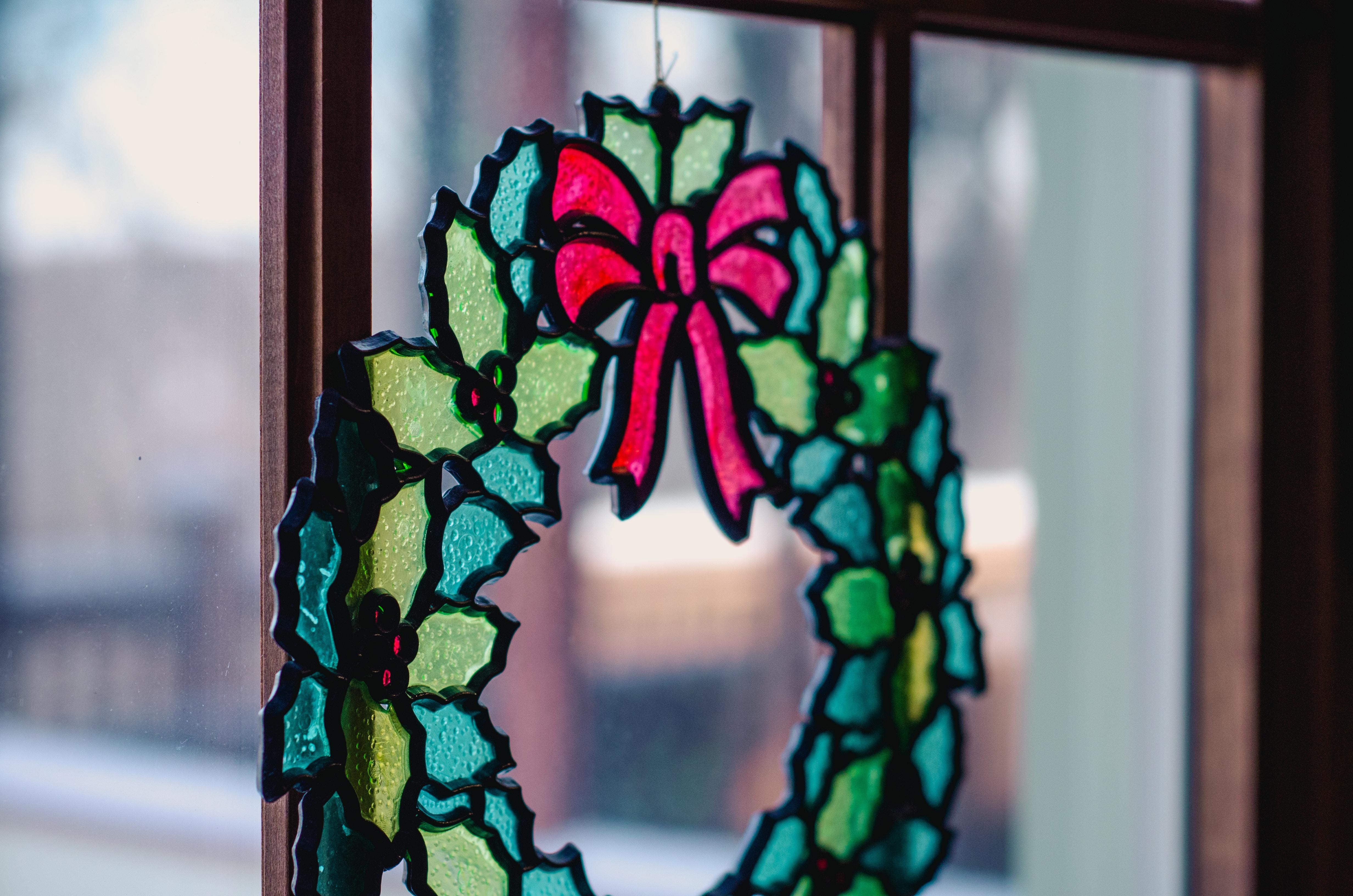 Christmas decor hanging at glass window