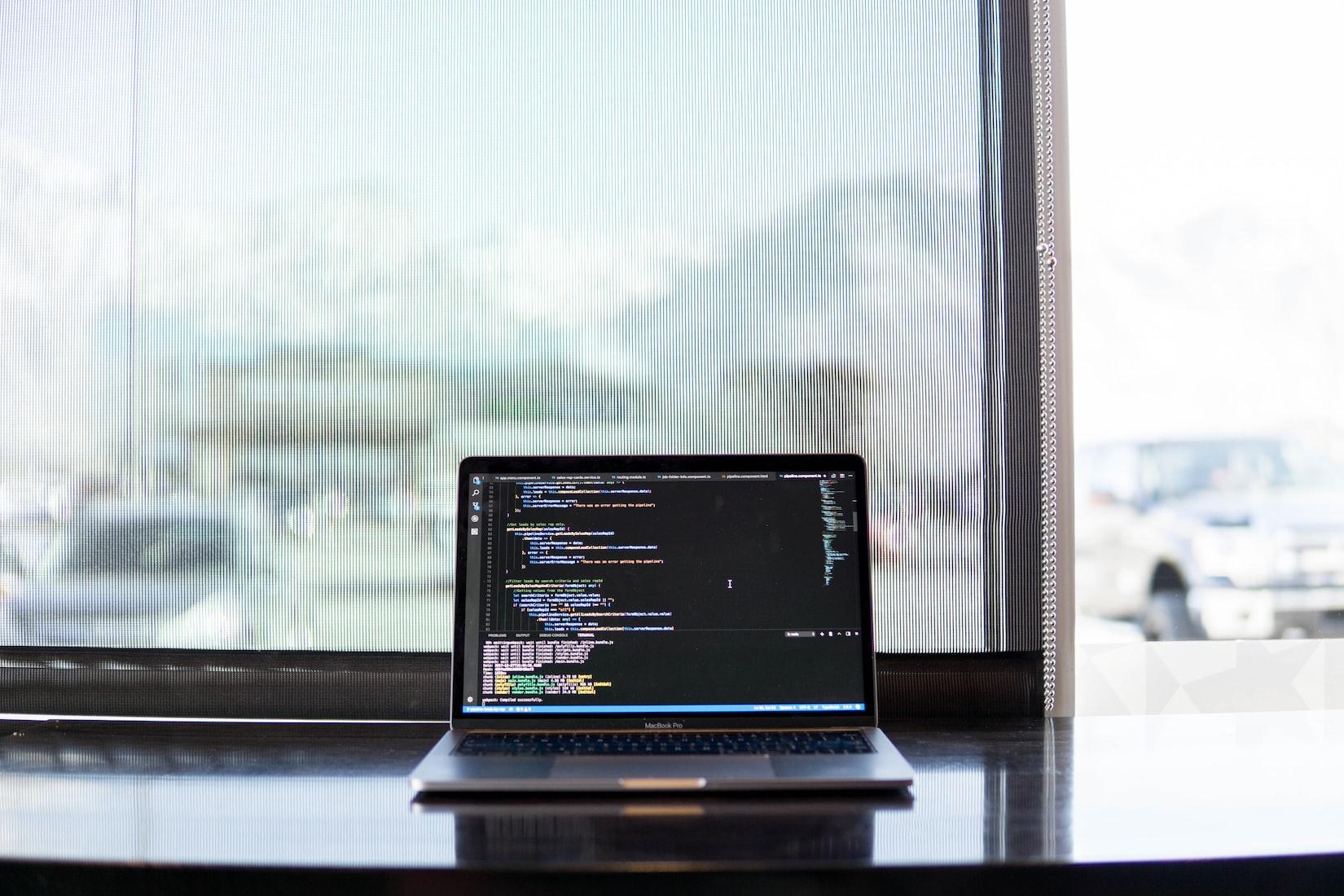 Macbook with Visual Code Open