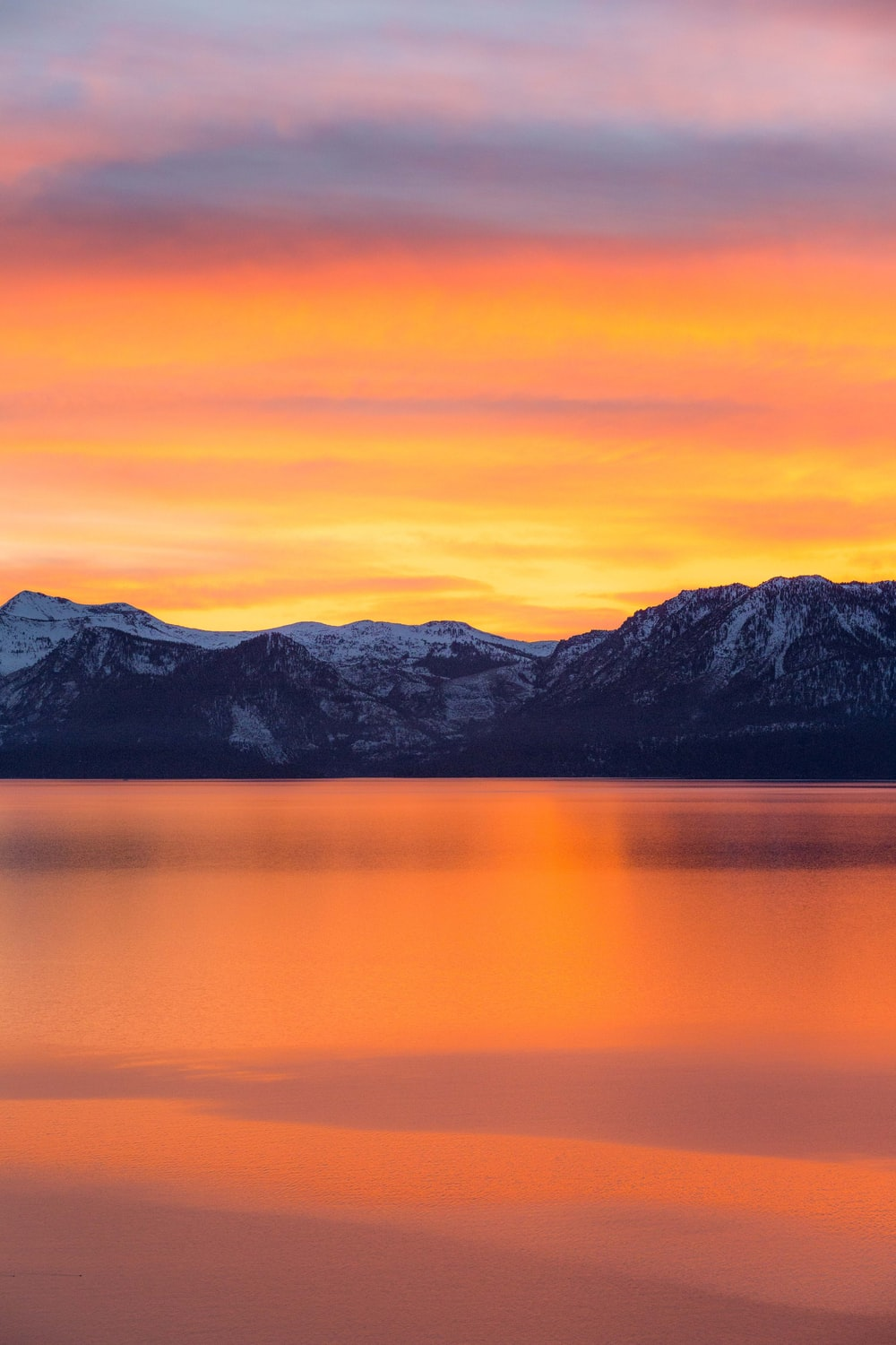 mountains and lake during sunset