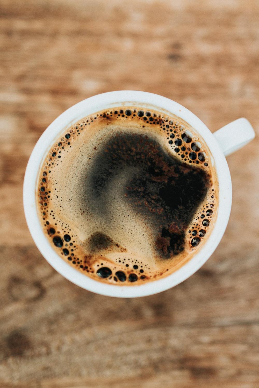 white ceramic mug filled with coffee