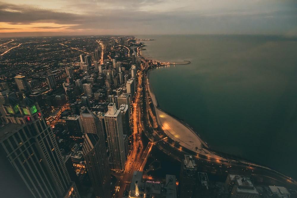 aerial photography of city skyline near ocean during golden hour