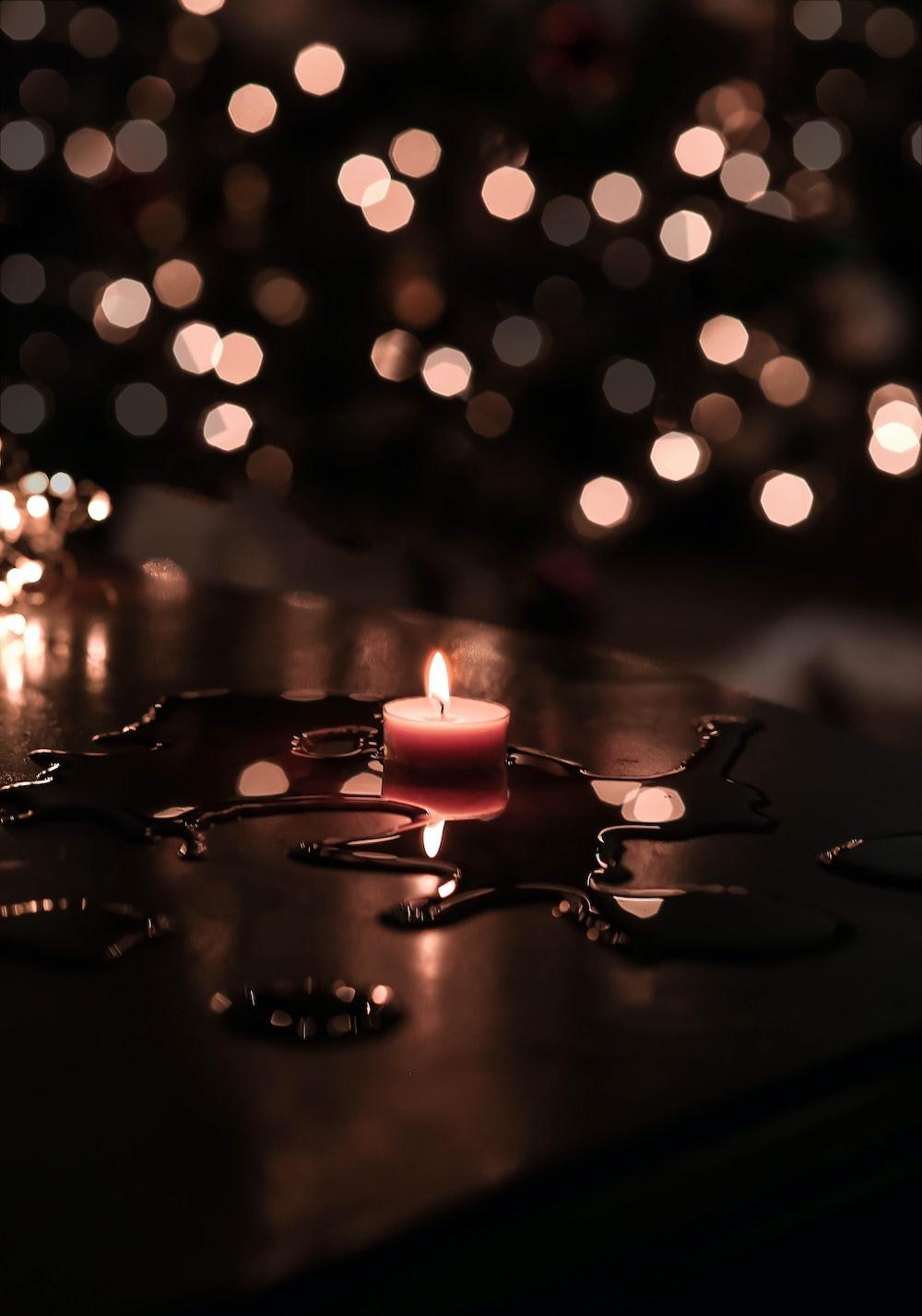 tilt shift lens photography of tealight candle