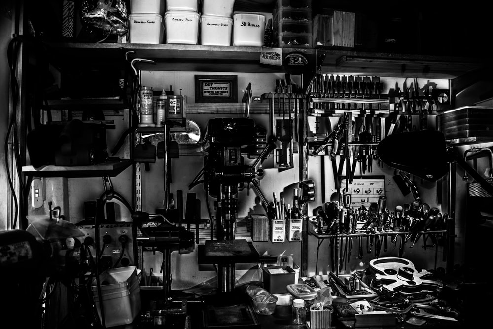 grayscale photography of metal tools