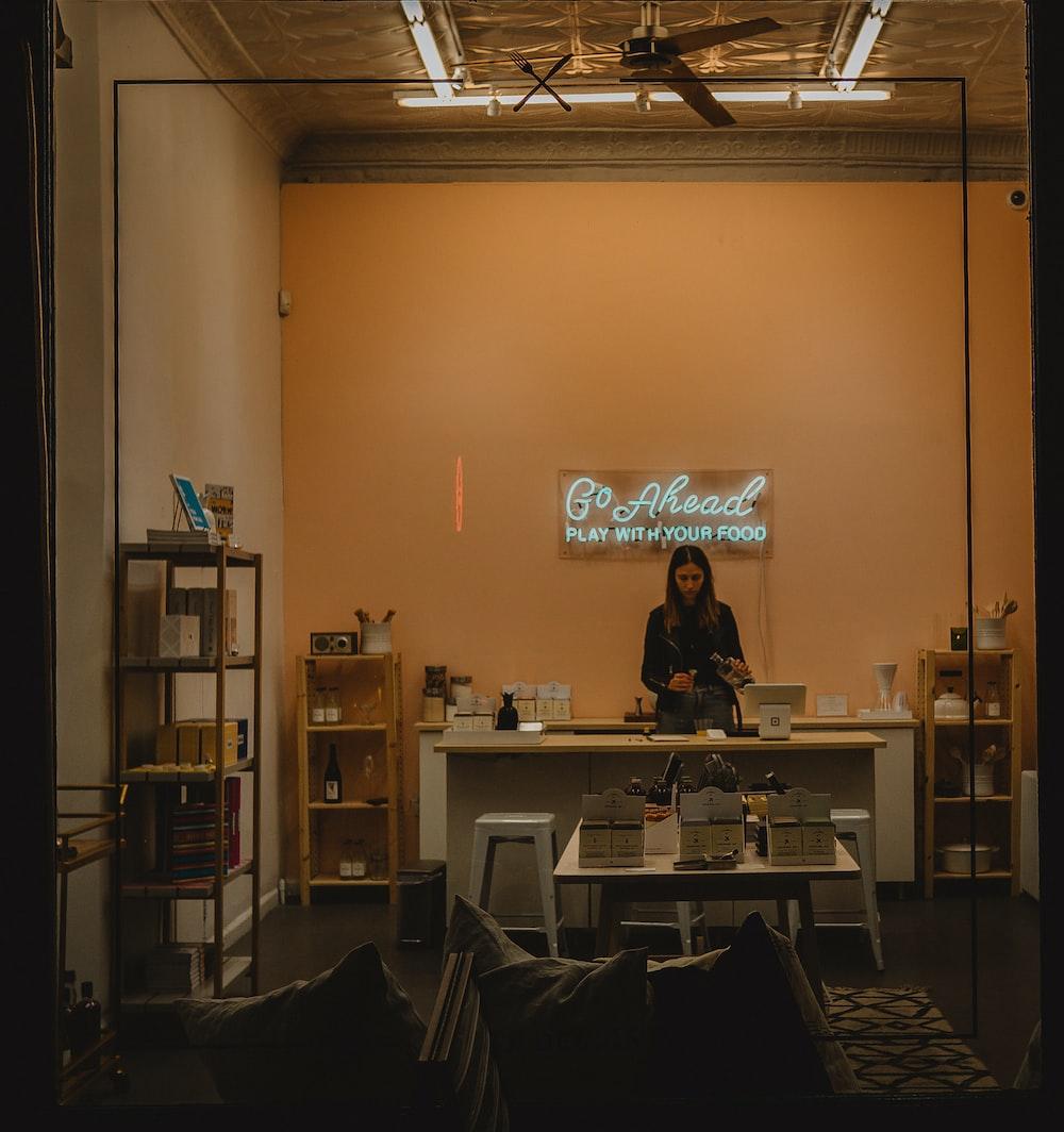 woman standing behind desk