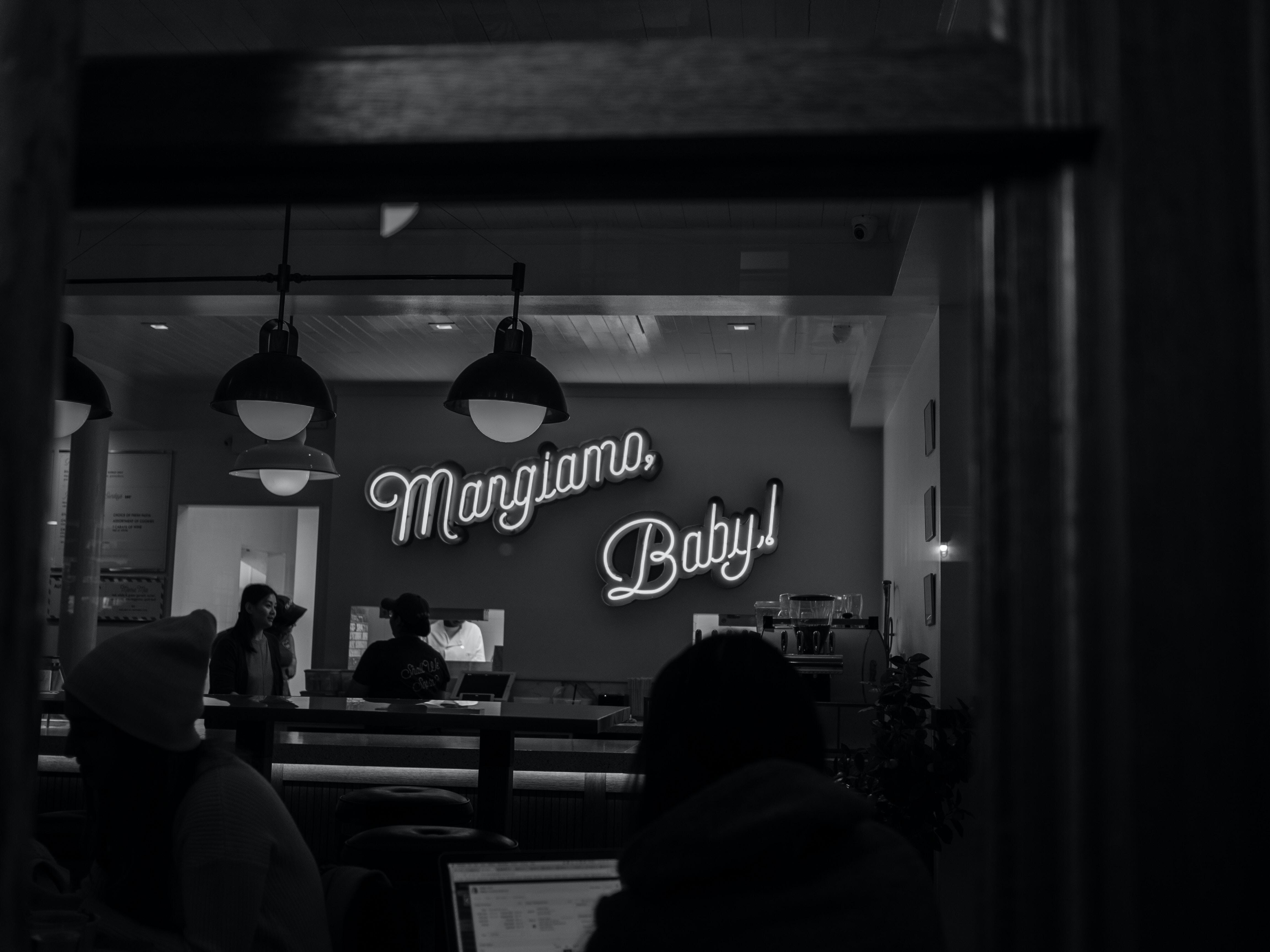 grayscale photography of Margiamo Baby! neon sign