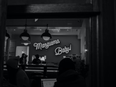 grayscale photography of Margiamo Baby! neon sign
