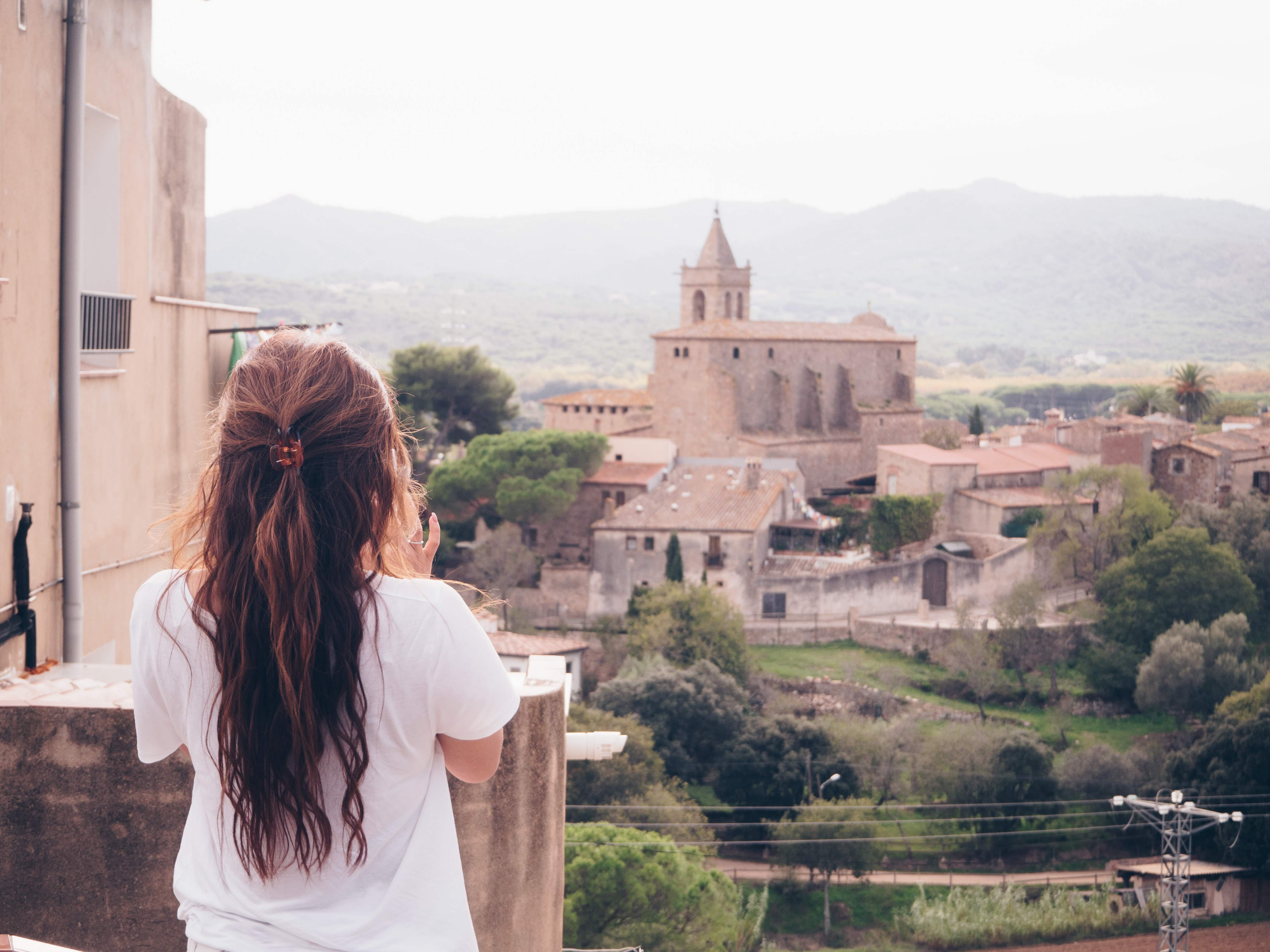 woman standing on terrace facing castle