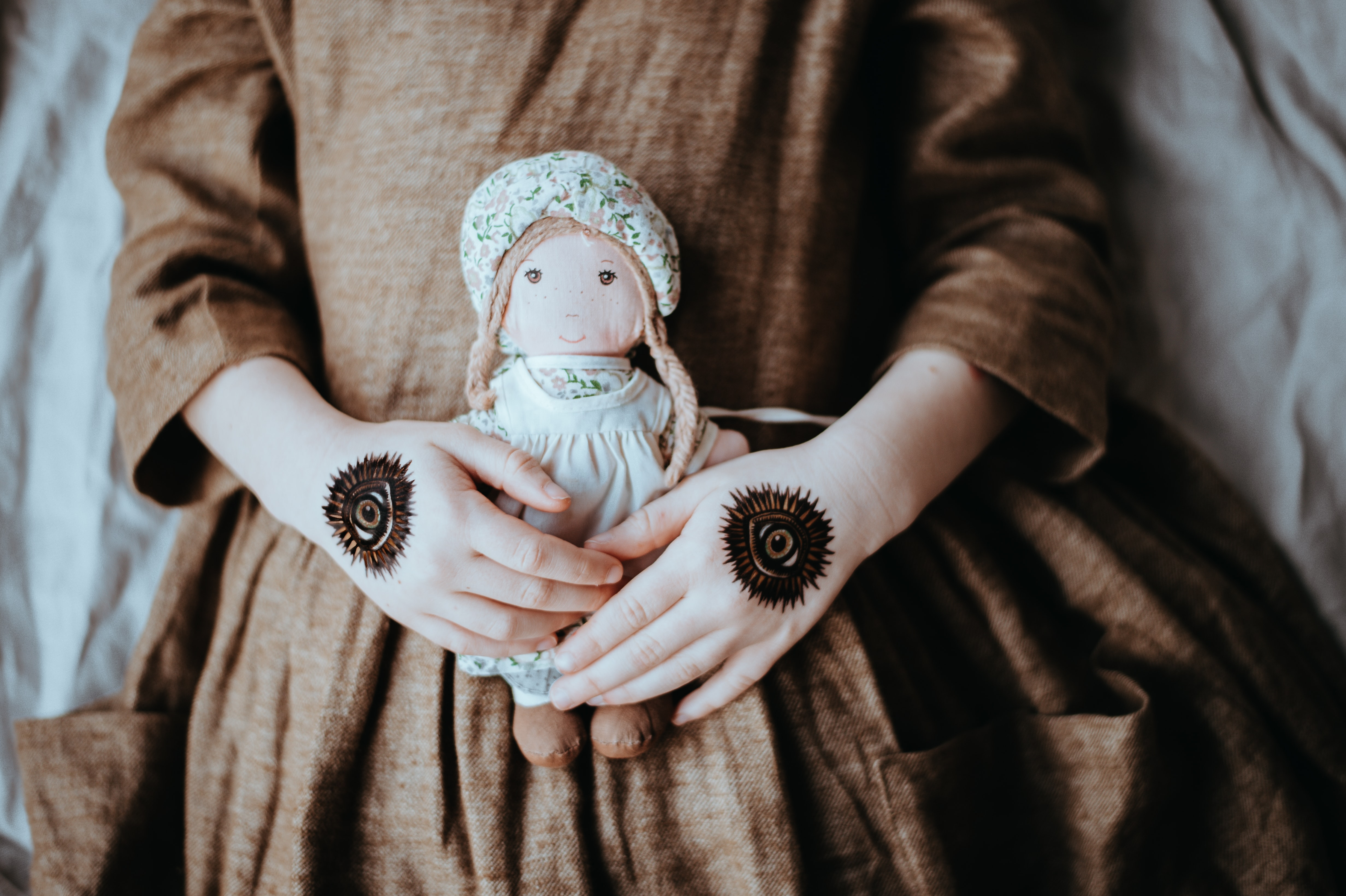 woman holding doll