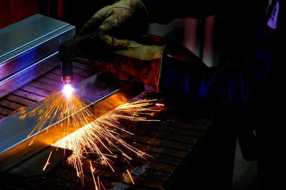 man holding welding torch