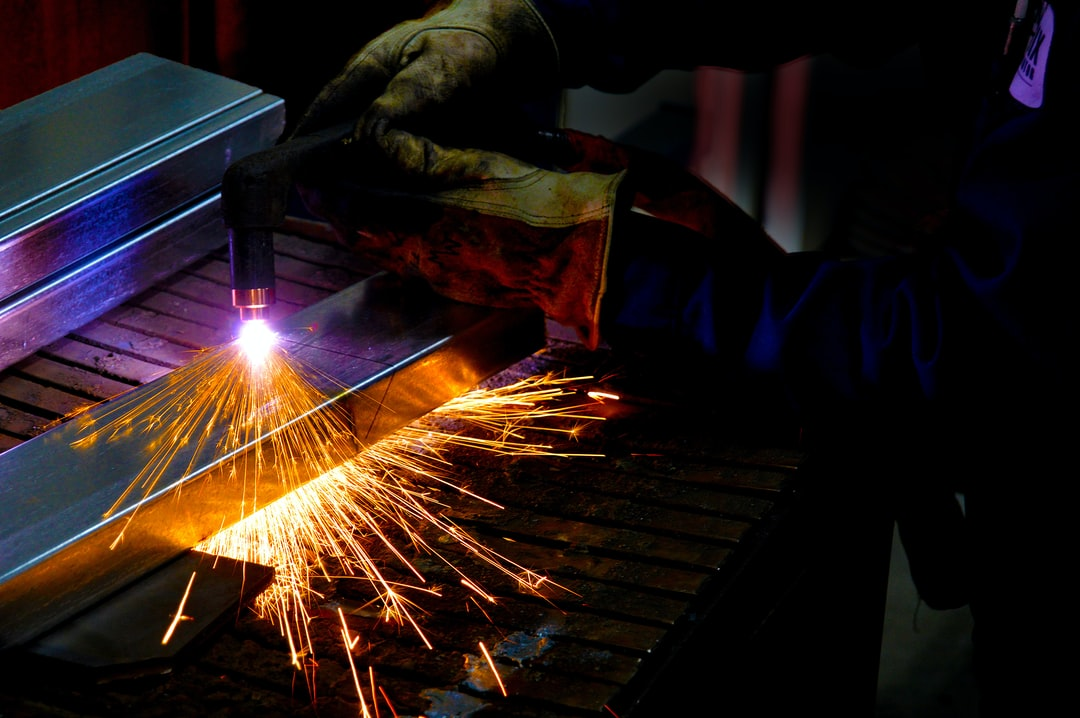 Plasma cutter in the hands of an expert. High quality work at a factory.