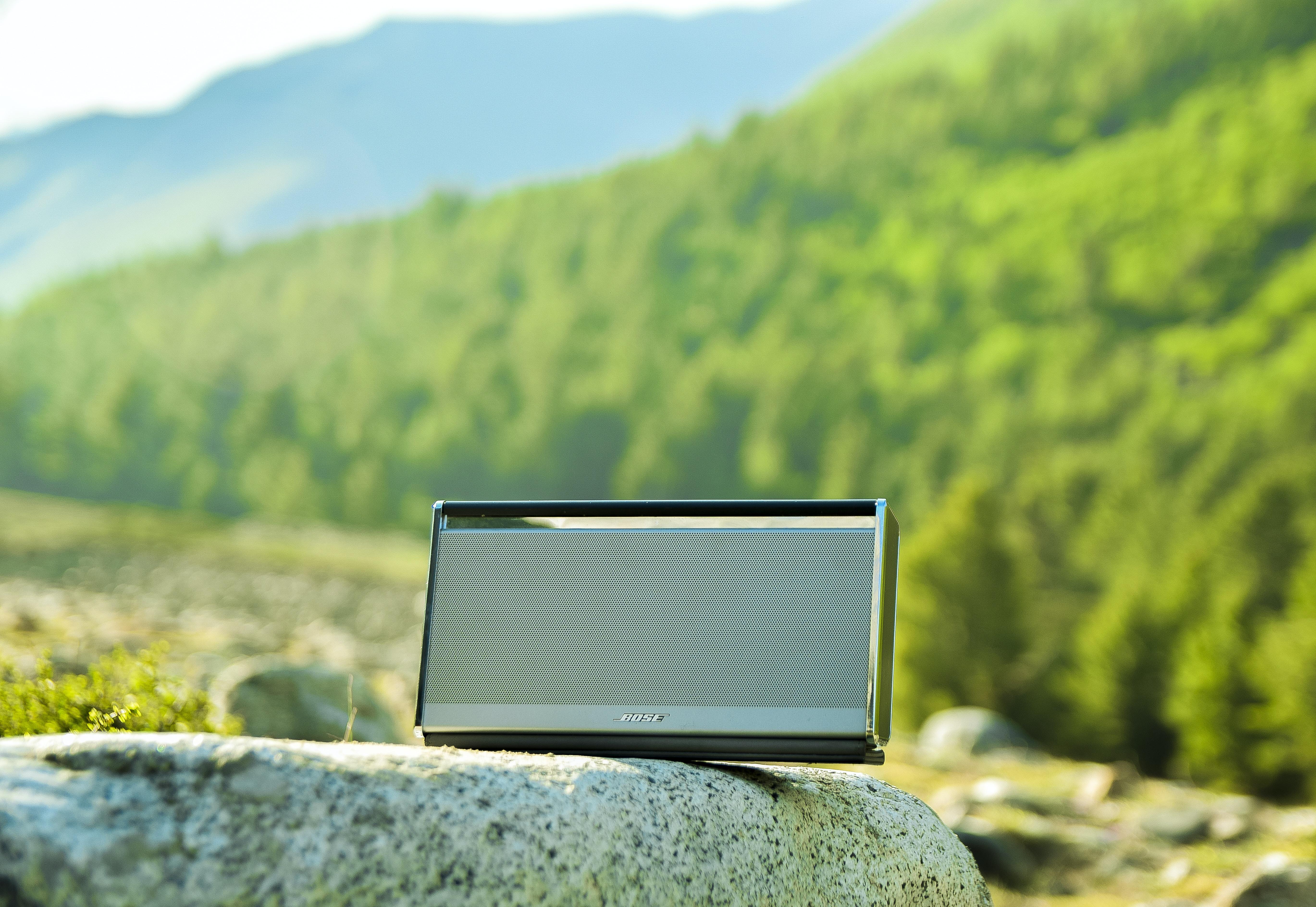 portable speaker on rock