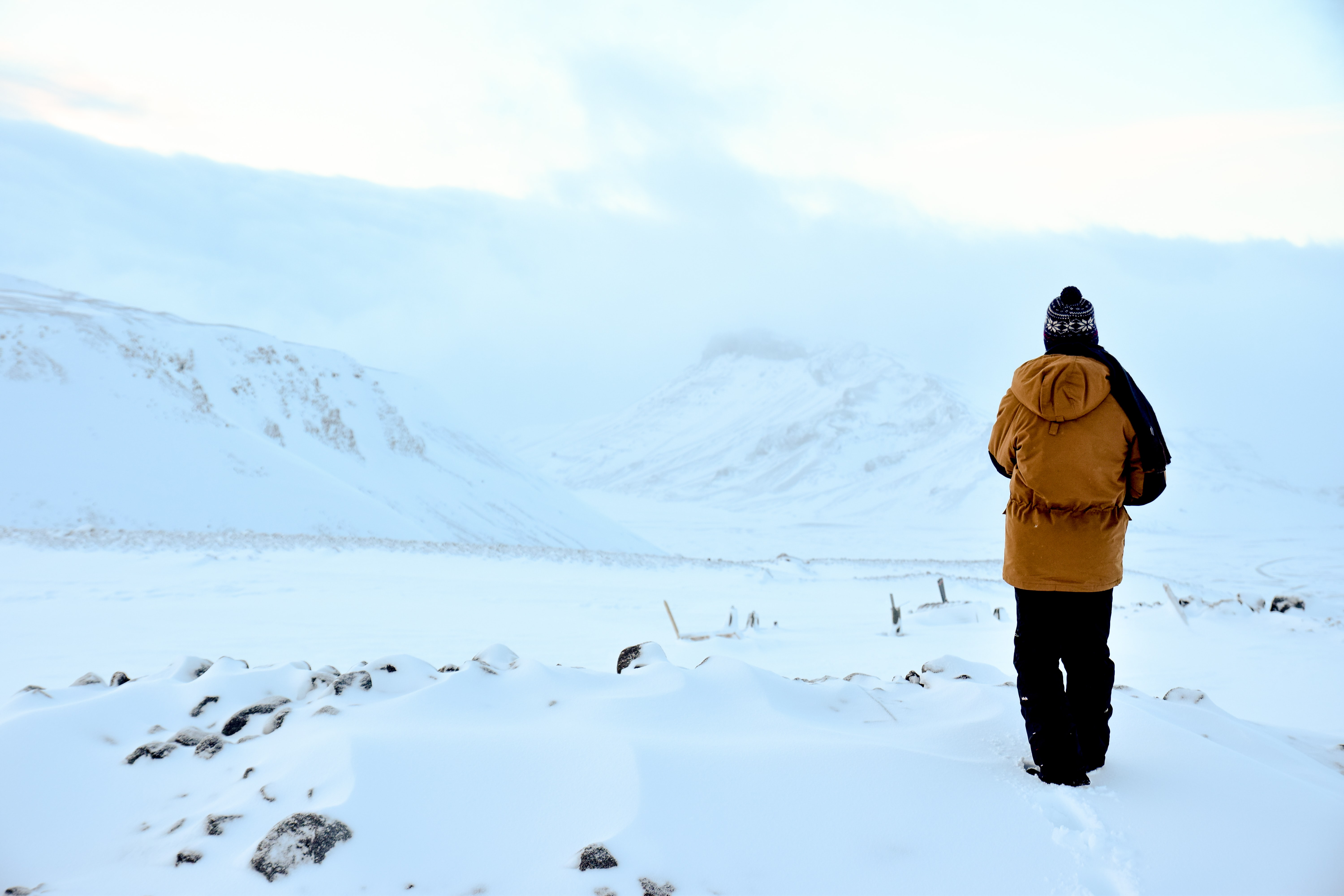 person walking on snow filled area