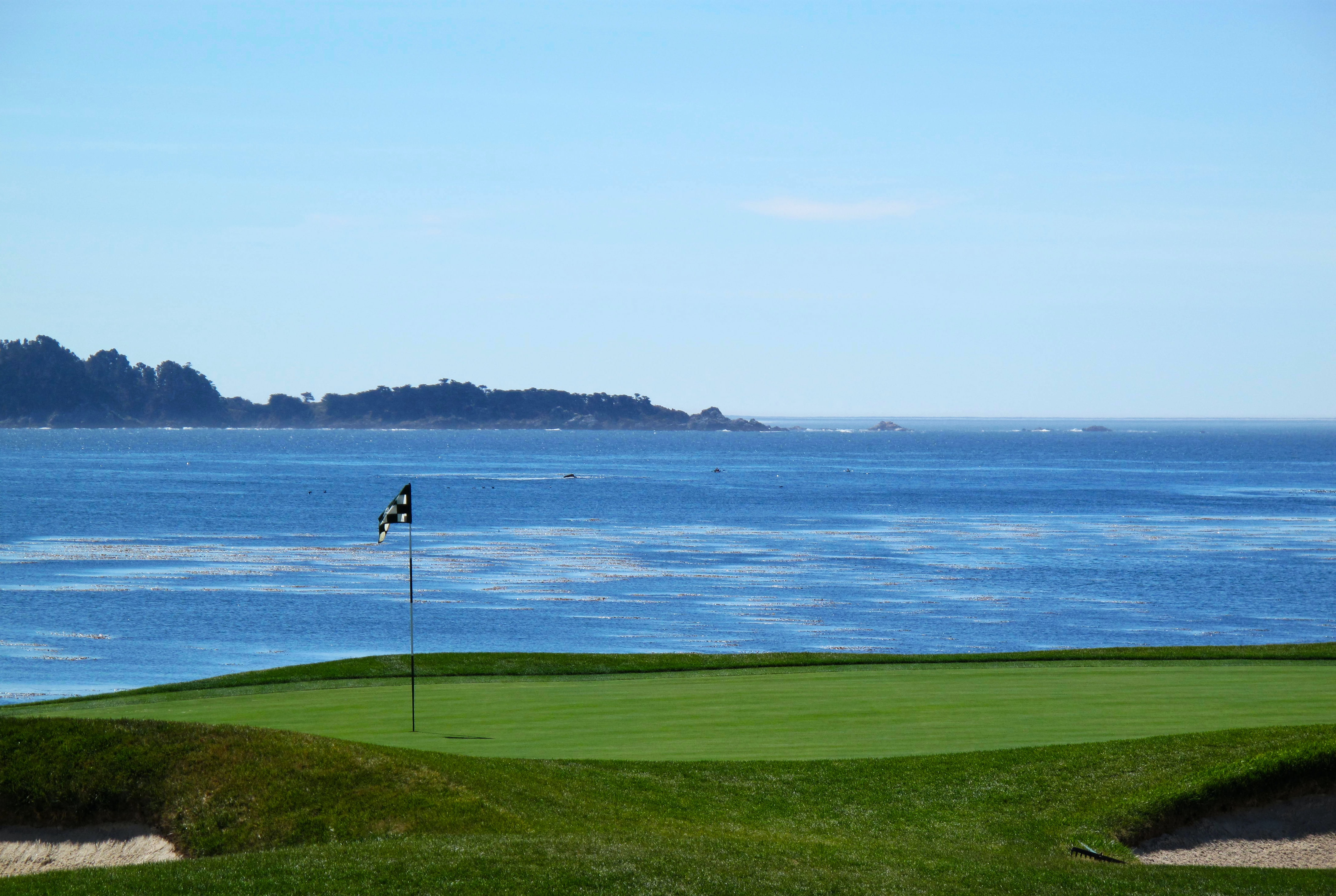golf course near body of water