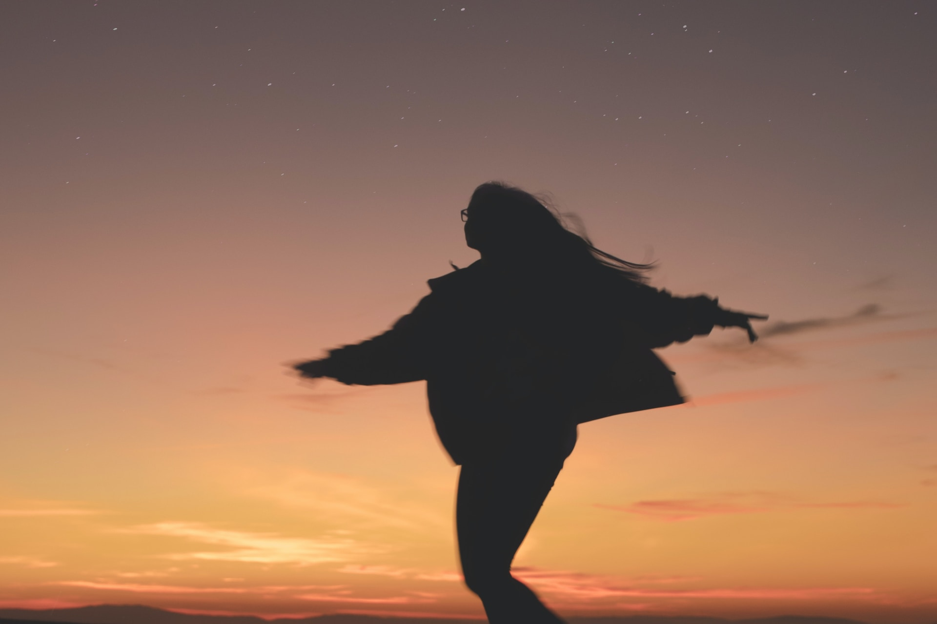 silhouette of woman running during golden hour