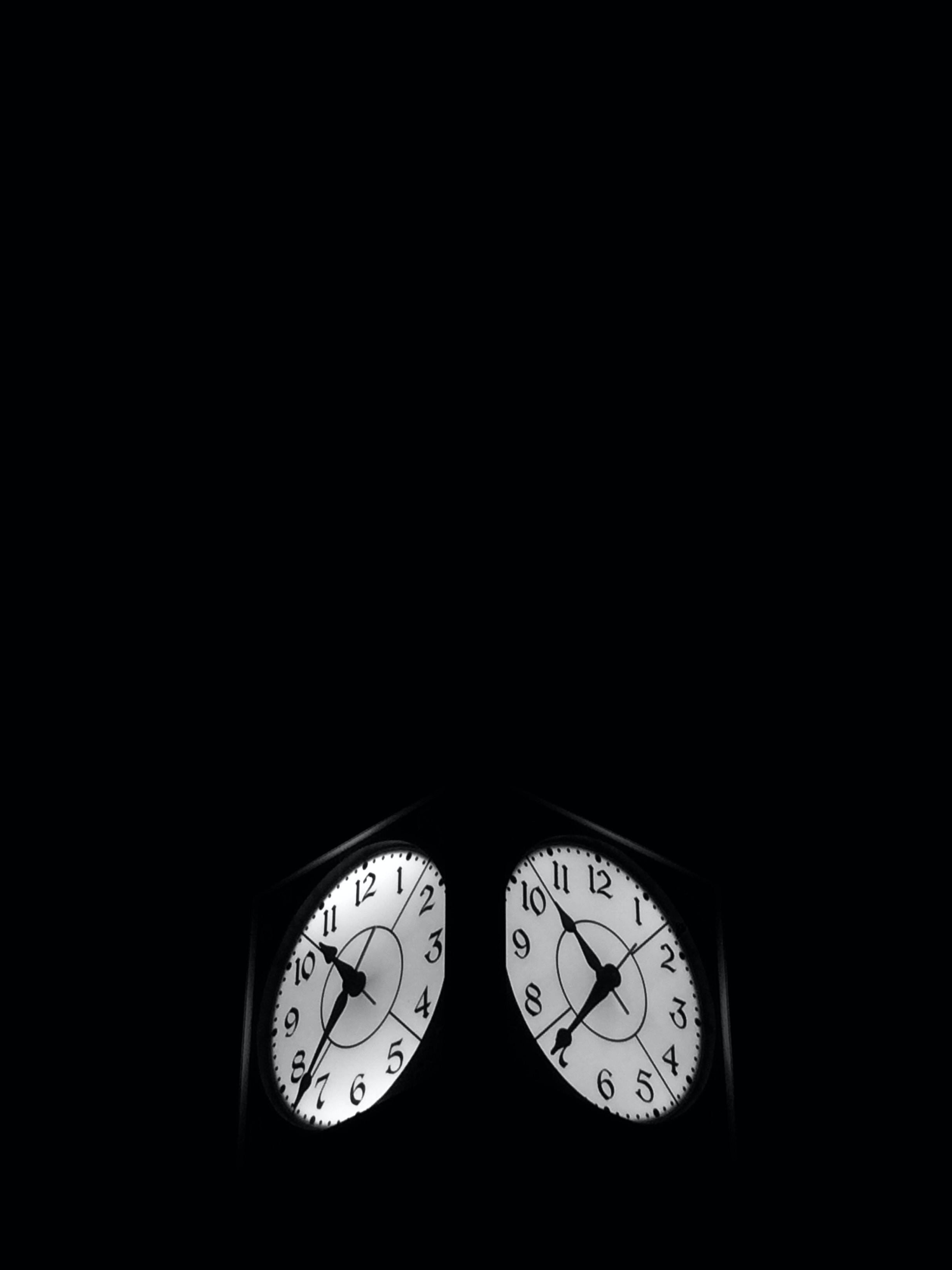 black clock displaying 7:52