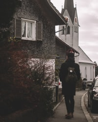 person walking towards the house