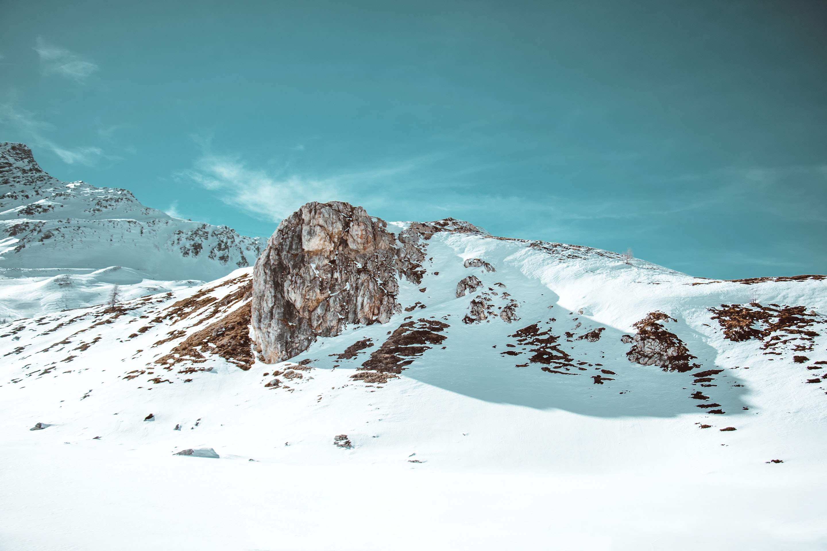 rock formation filled with snow