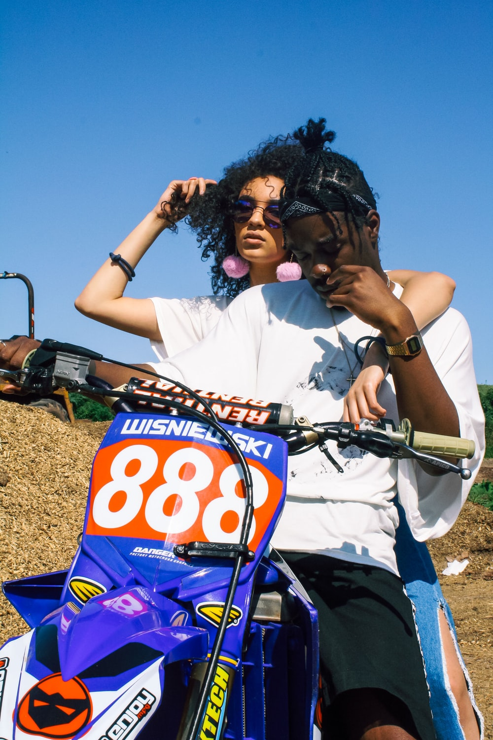 man riding enduro motorcycle with woman
