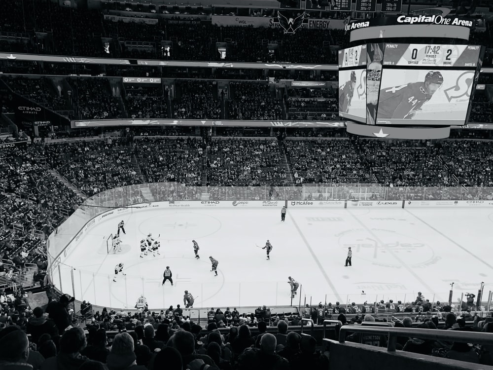 ice hockey players on ice hockey arena