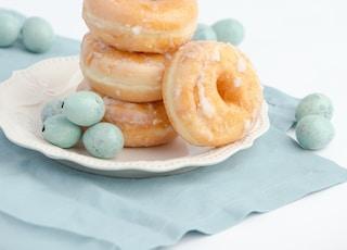 four doughnut on plate
