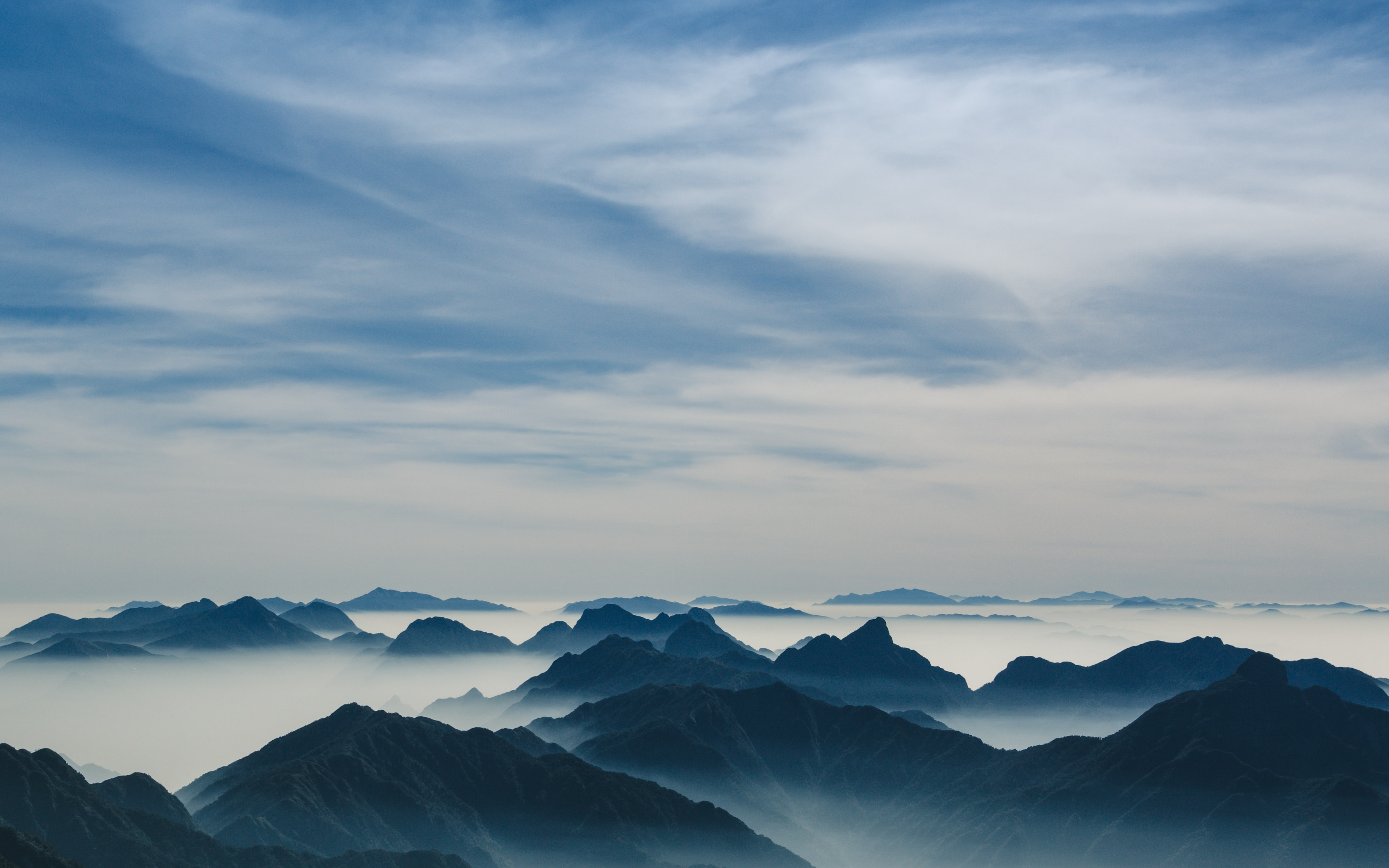 mountains under cloudy sky
