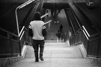 grayscale photo of person wearing hoodie walking on stairs ethiopia zoom background