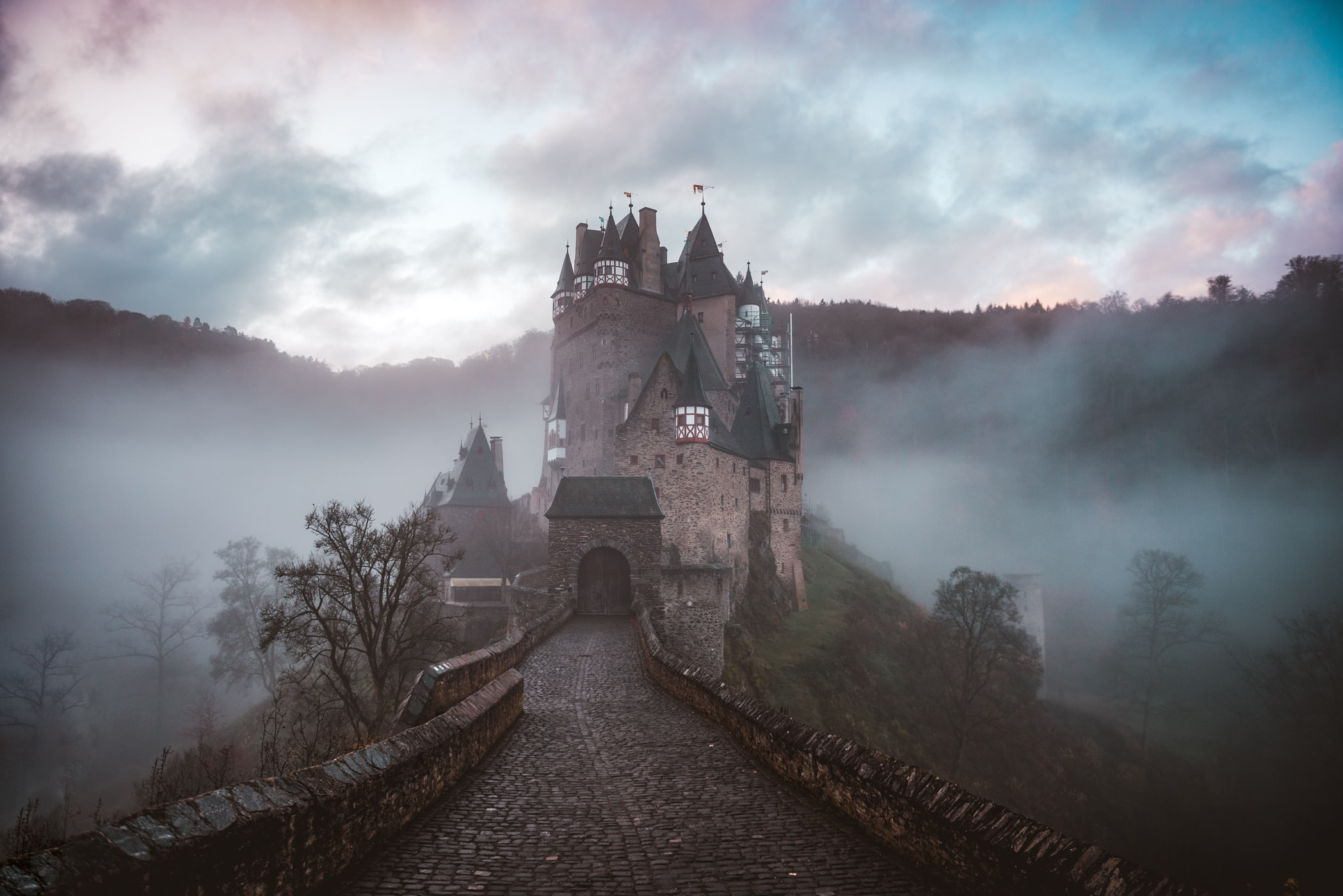 closeup photo of castle with mist