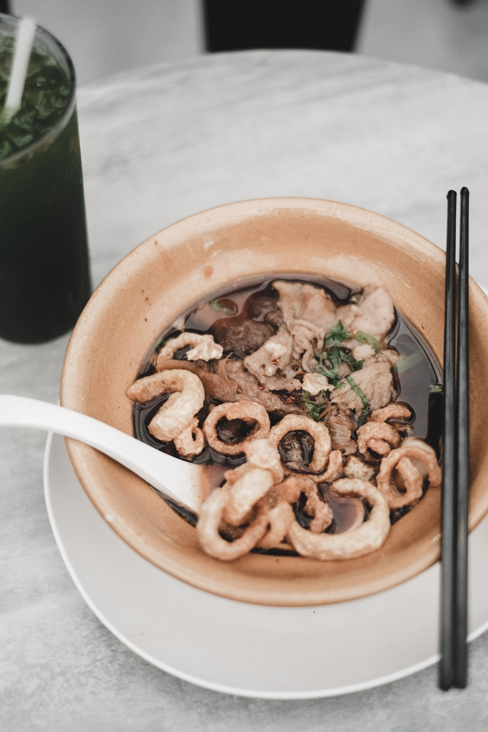 cooked dish with chopsticks