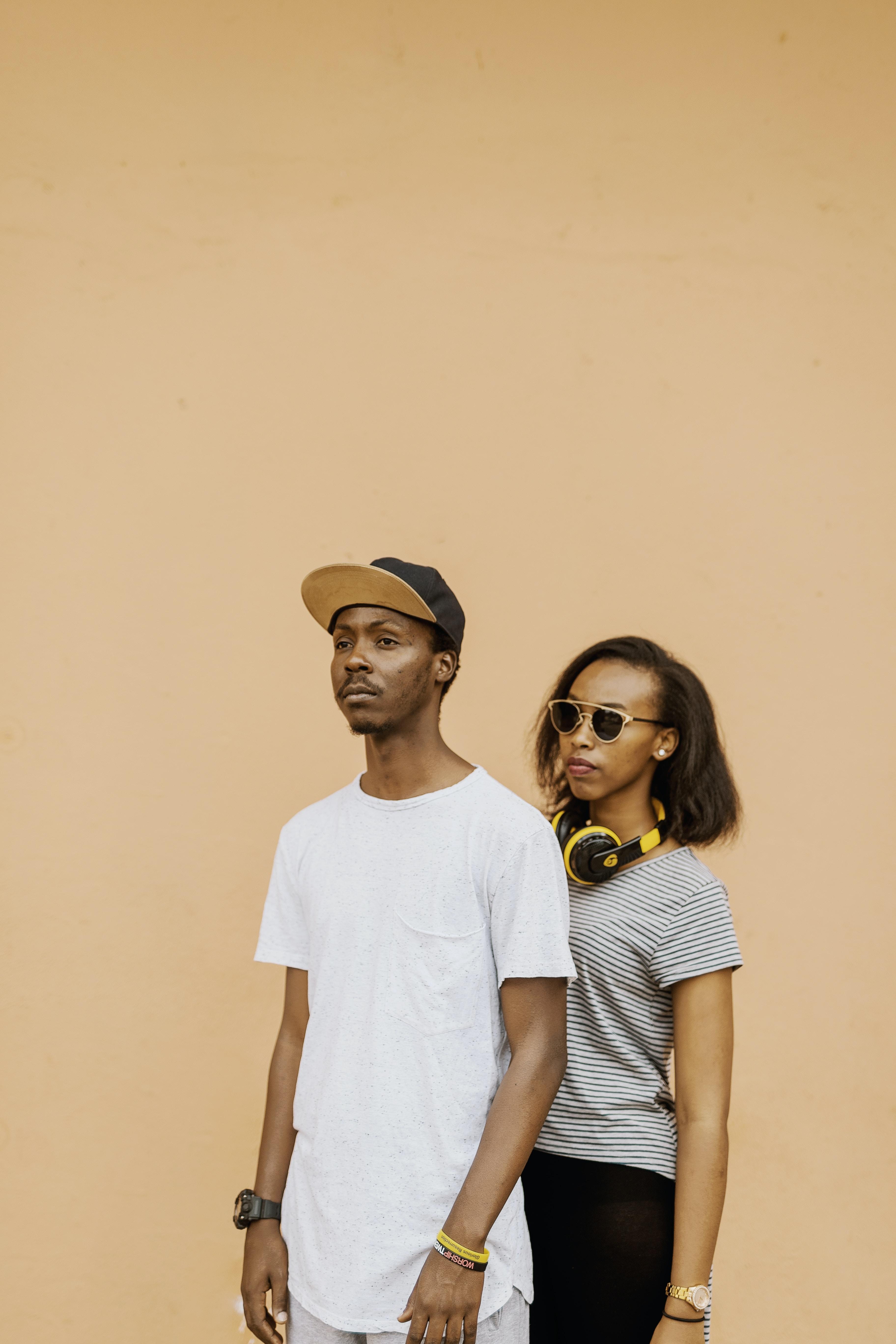 man beside woman wearing sunglasses