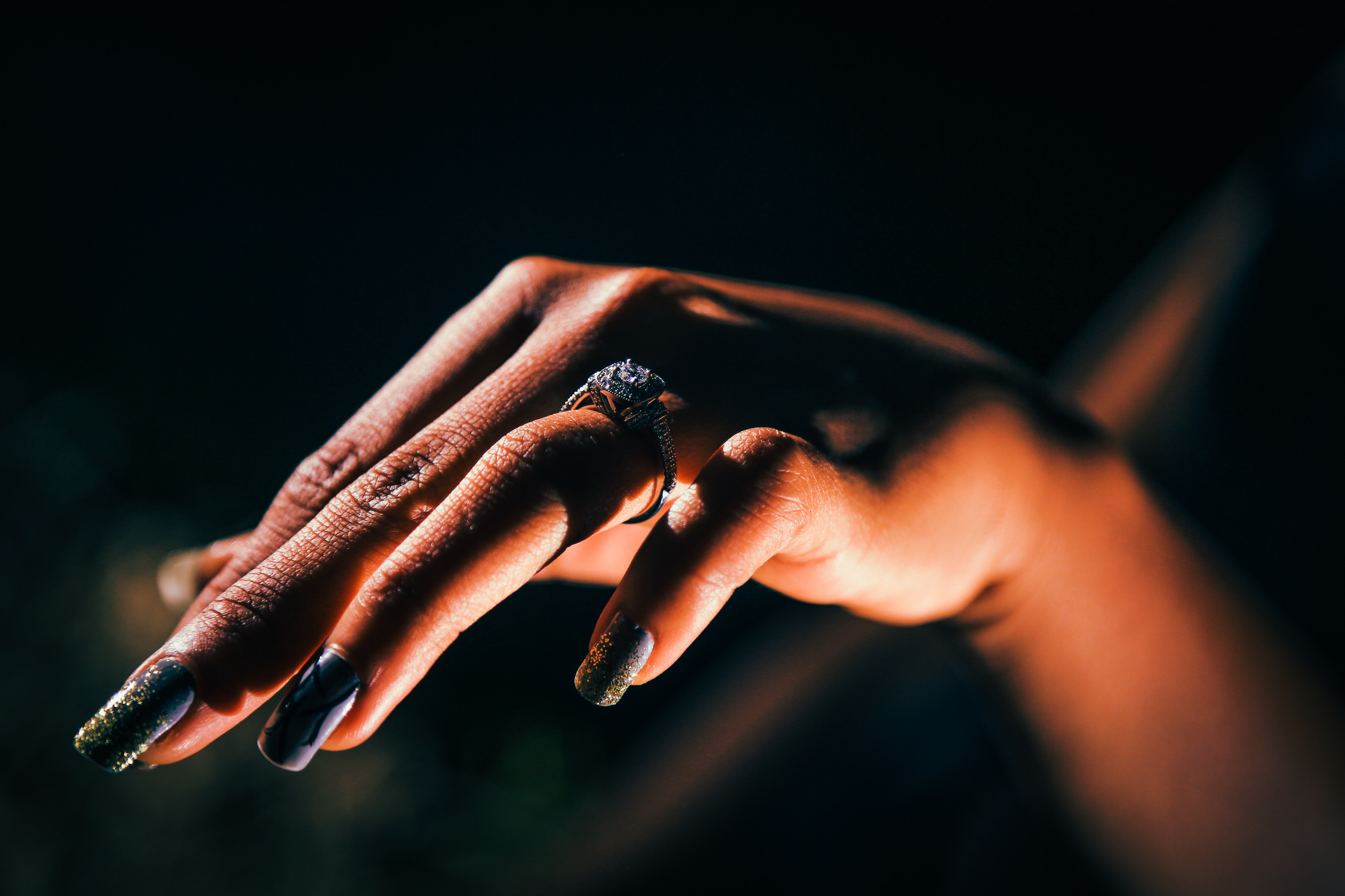woman showing hand with ring