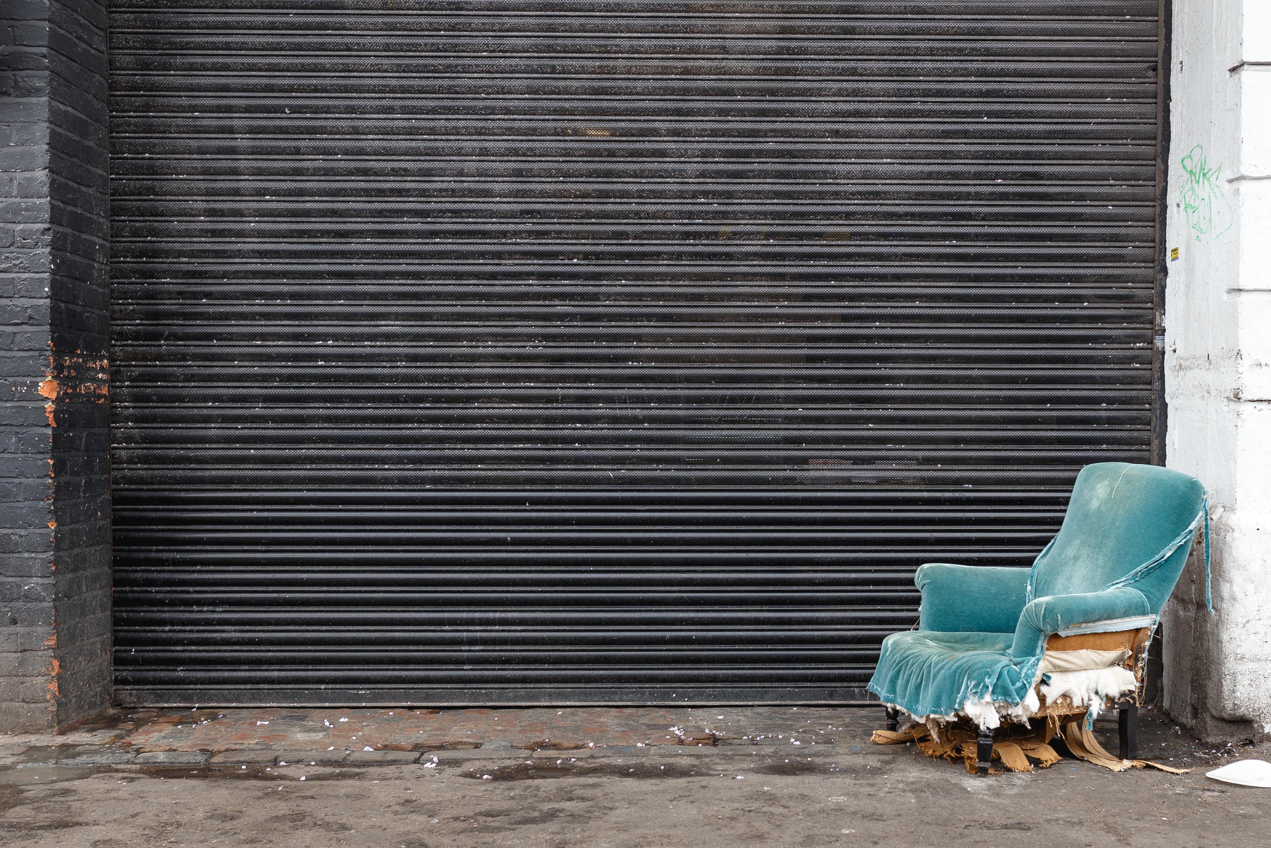 blue tube chair beside door shutter