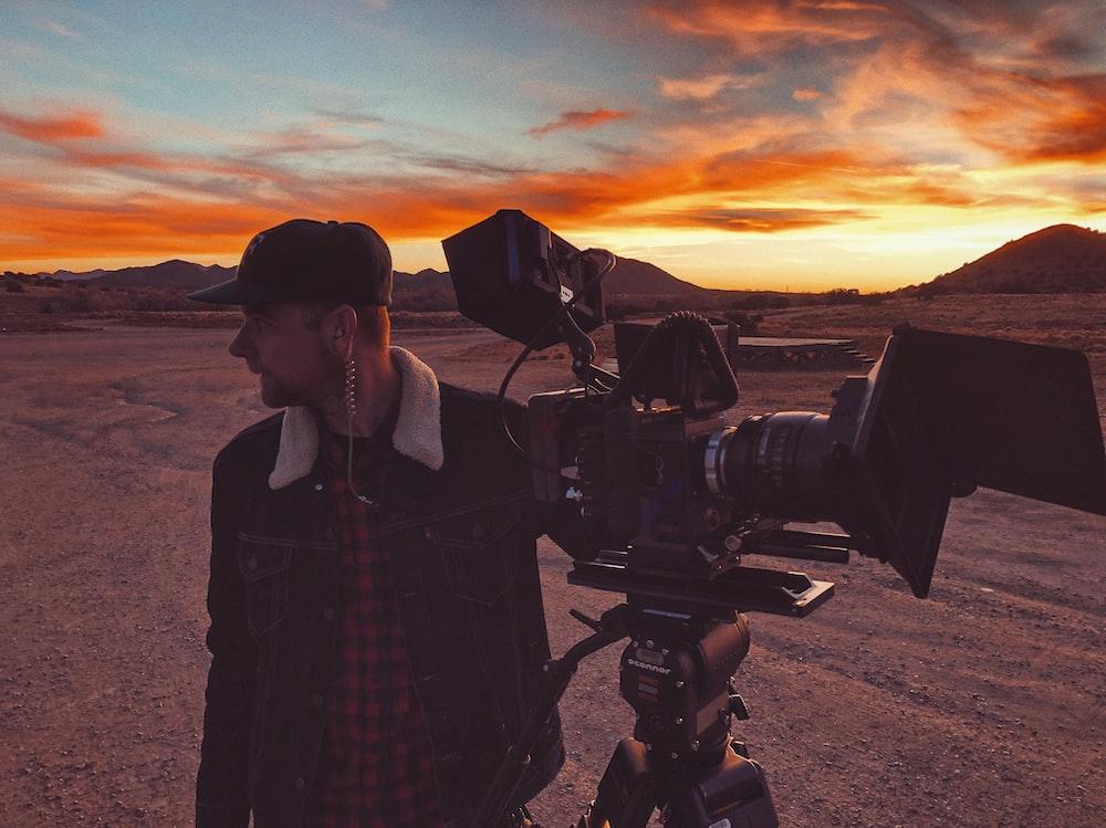 man holding camera at the desert