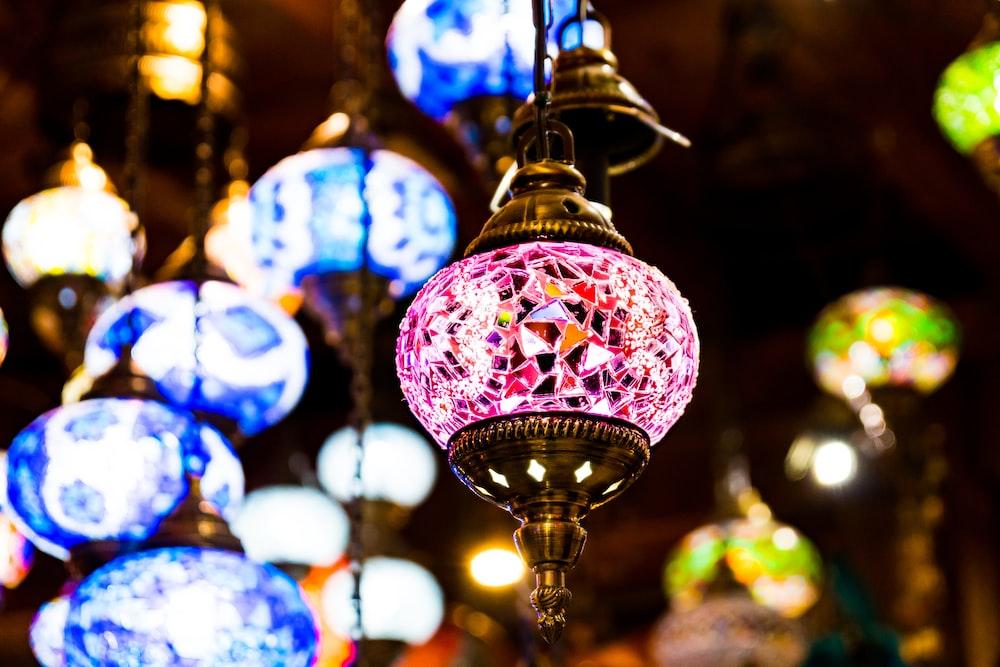 shallow focus photo of purple pendant lamp
