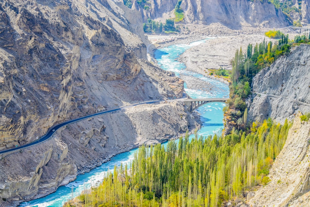 aerial photography of river surrounded by mountains