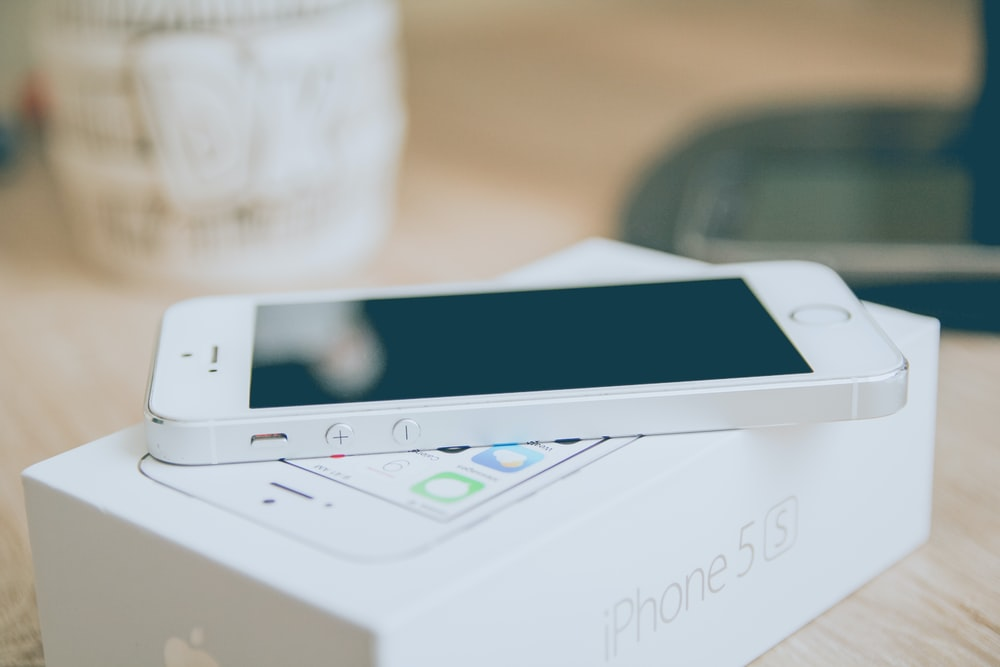 silver iPhone 5s on box