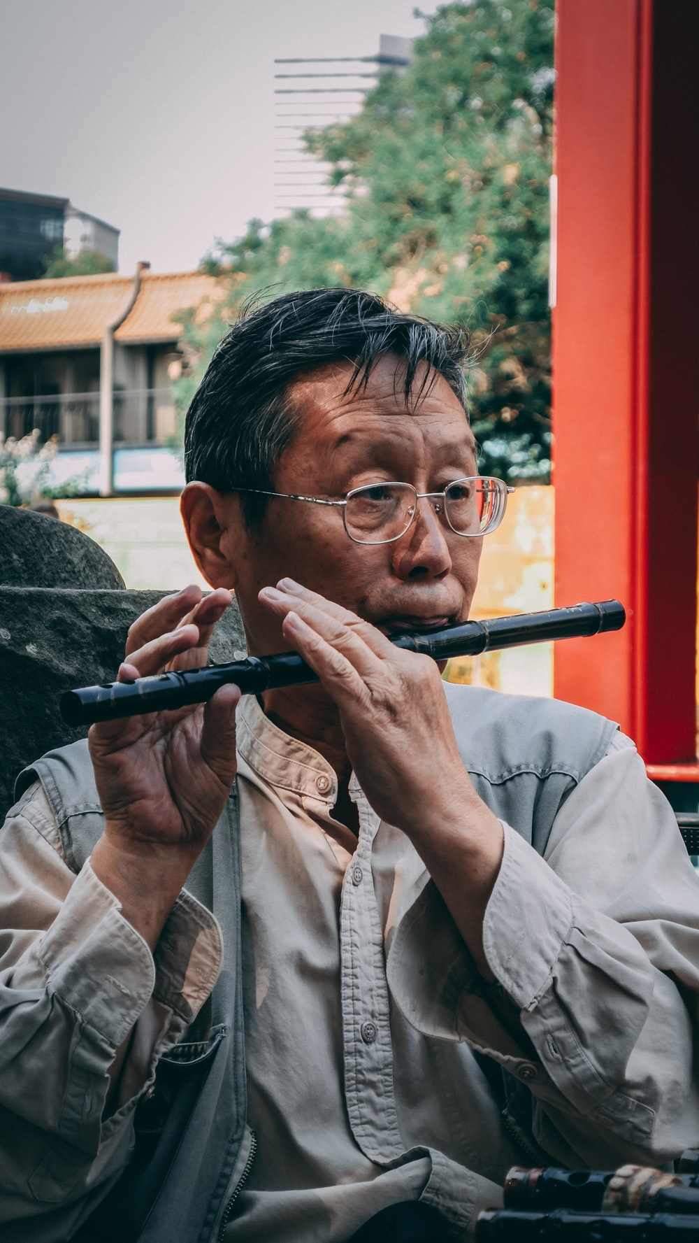 man playing black flute