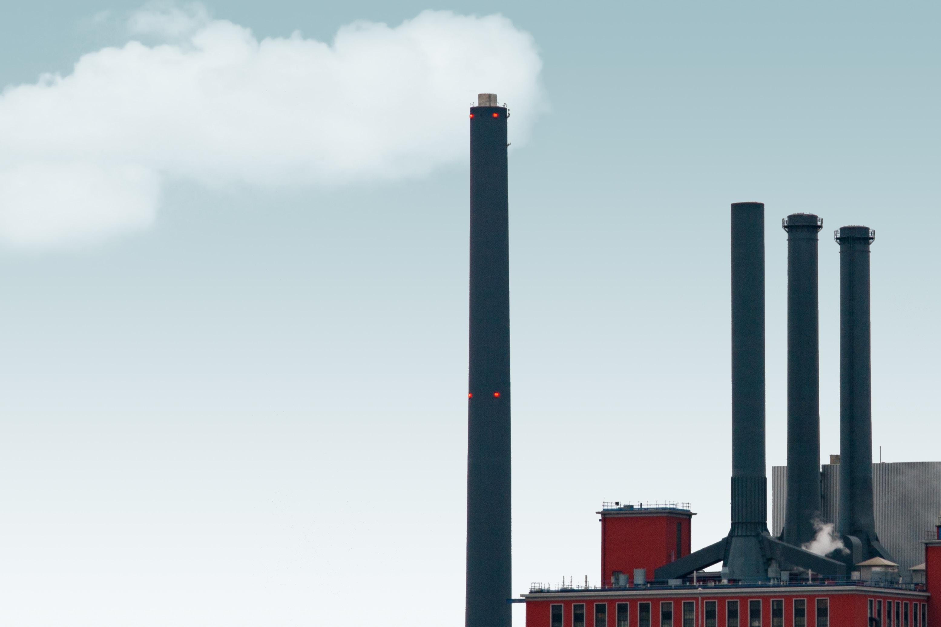 gray exhaust emitting white smoke