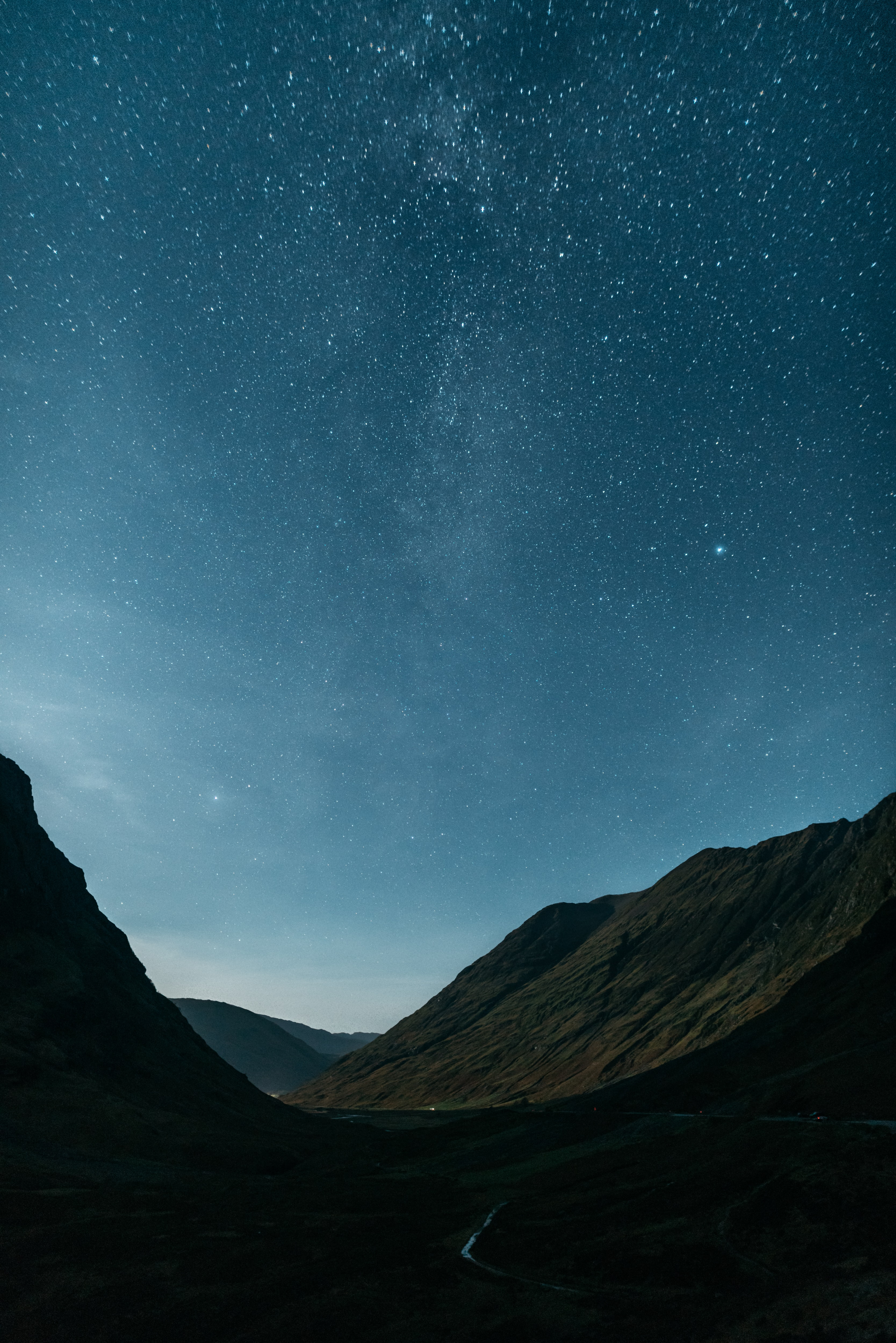 stars over mountains during daytime