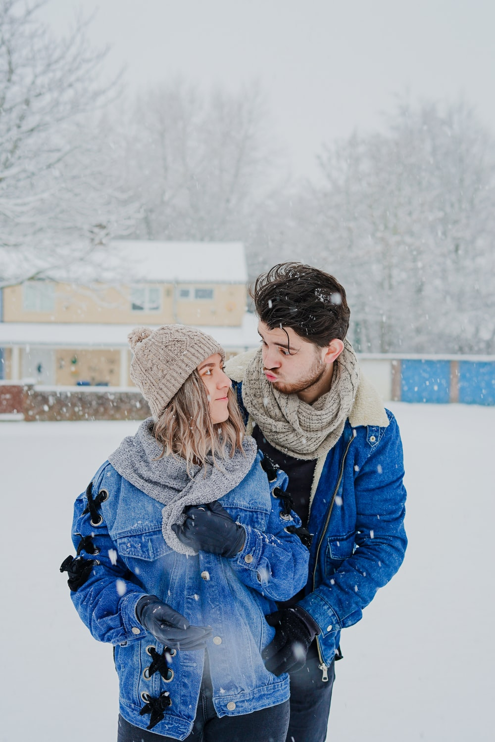 man and woman standing outside during winter