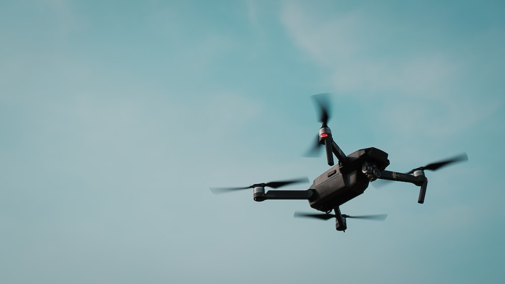 black and gray quadcopter drone