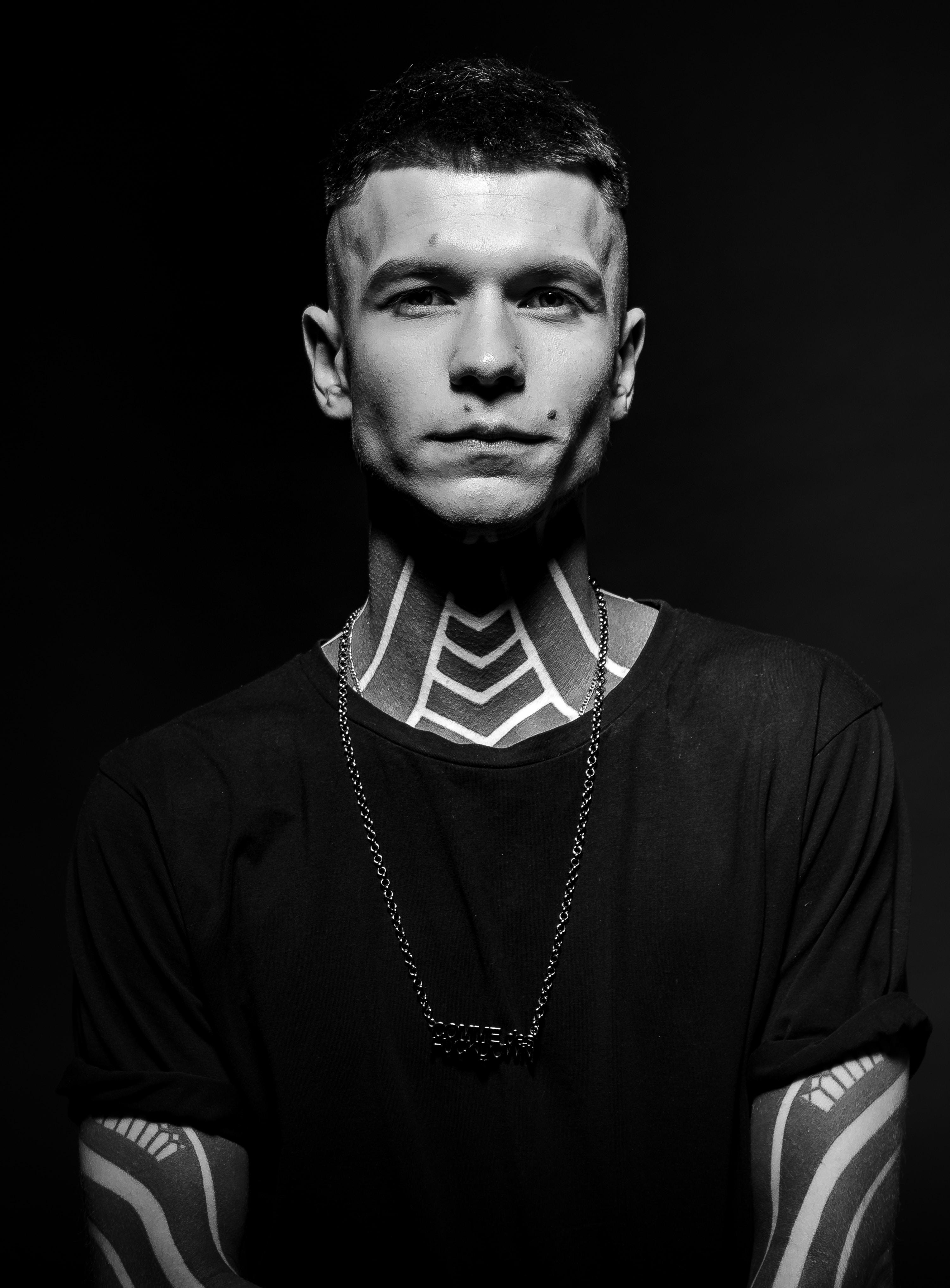 man wearing black crew-neck shirt