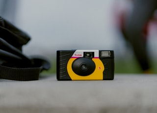 selective focus photograph of black and yellow Kodak camera