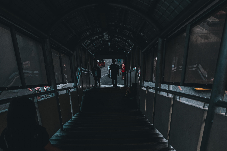 people on footbridge stairs during daytime